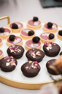 small chocolates with magenta white chocolate shavings, blackberry fruit tart