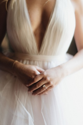bride in tulle wedding dress v neck solitaire engagement ring bracelet