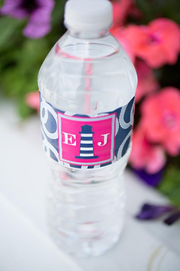 Pink and navy blue water bottle label with lighthouse design