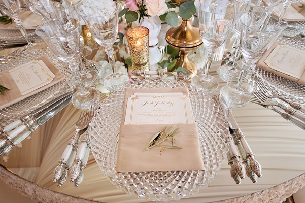 Mirror table cut crystal charger plate menu in napkin gold candle votives and white silver flatware