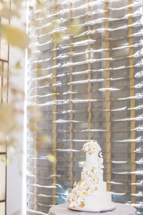 white 5 tier cake cascading ivory florals down modern classic delicious new york city jewish wedding