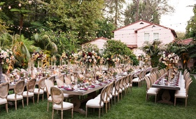 wedding reception hotel bel-air long wood tables fall inspired centerpiece flower arrangements