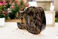 black acoustic guitar with gold signatures for wedding guest book