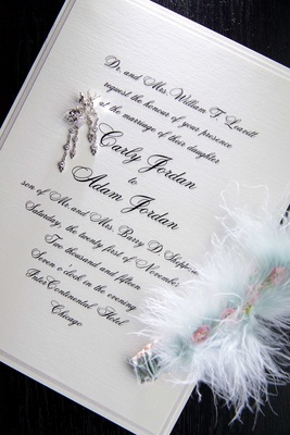 Classic wedding invitation white with black script calligraphy feather garter blue and earrings