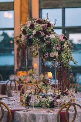 textured linens, rock crystal stands, cascading orchids, burgundy amaranthus, gold and silver stands