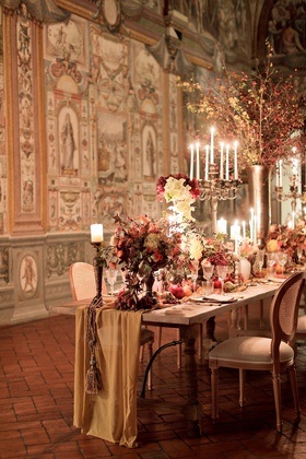 renaissance inspired tablescape in palace in florence, fabric table runner with tassel from candle