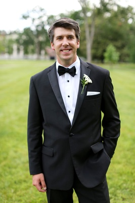 groom in classic black-and-white suit