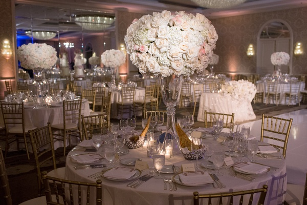 ivory and blush roses held by crystal stand, gold chiavari chairs
