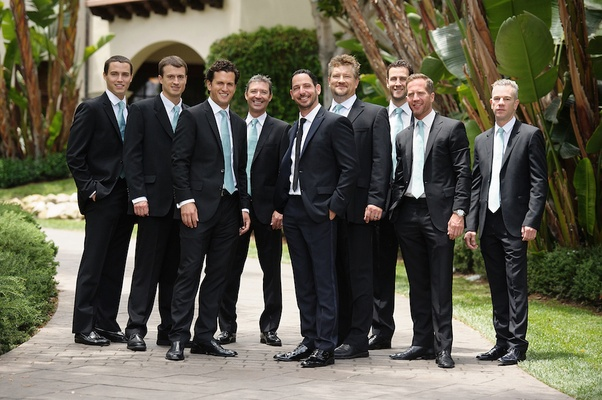 Matt Katrosar and groomsmen in black tuxedos