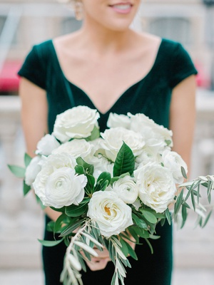 bridesmaid in velvet emerald green dress holding ivory bouquet with garden rose and ranunculus