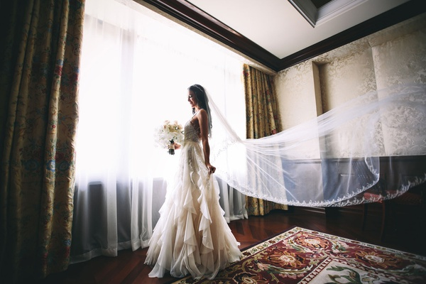 bride in elegant inbal dror wedding dress with peter langner veil styled by maradee wahl bouquet