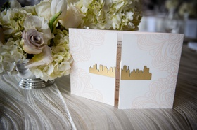 wedding invitation booklet with gold skyline cutout houston texas pink floral motif on folds