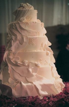 Feminine white wedding confection with ribboned fondant