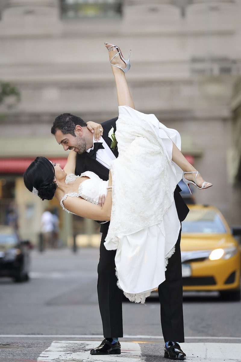wedding ceremony new york city%0A     Bride in Inbal Dror lace dress with crystal  pearl straps  strappy  Louboutin heels carried