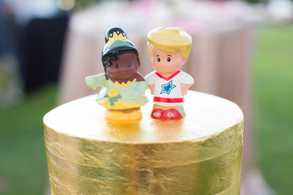 Wedding cake gold foil layer with Fisher Price Little People toys Chudney Ross Joshua Faulkner