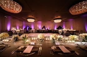 Wedding reception Fairmont Miramar Hotel & Bungalows ballroom purple lighting and white flowers grey