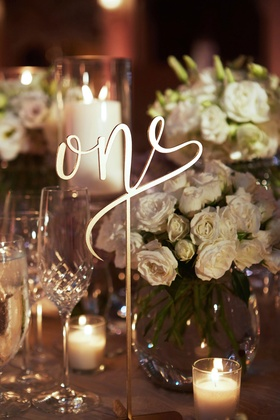 Modern calligraphy laser cut table number one on wedding reception table at The Breakers