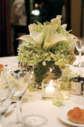 Calla lily and hydrangea filling glass vase