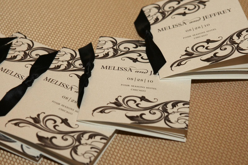 Ceremony program with black and white scroll design