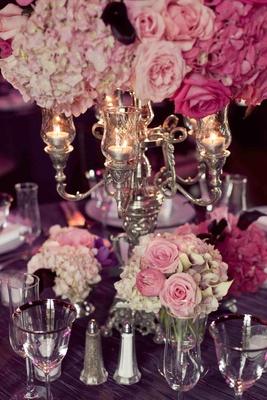 Hydrangea, rose, calla lily flowers below candelabra