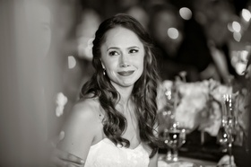 bride filled with emotion listening to toasts at Los Olivos wedding
