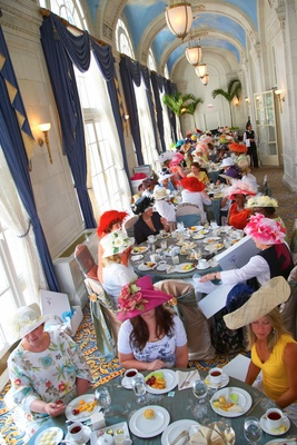 Tea party women guests under arched painted cloud ceiling