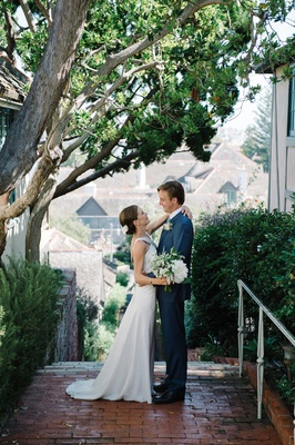 bride groom first look oceanside california small town blue suit suzanne neville dress bouquet trees
