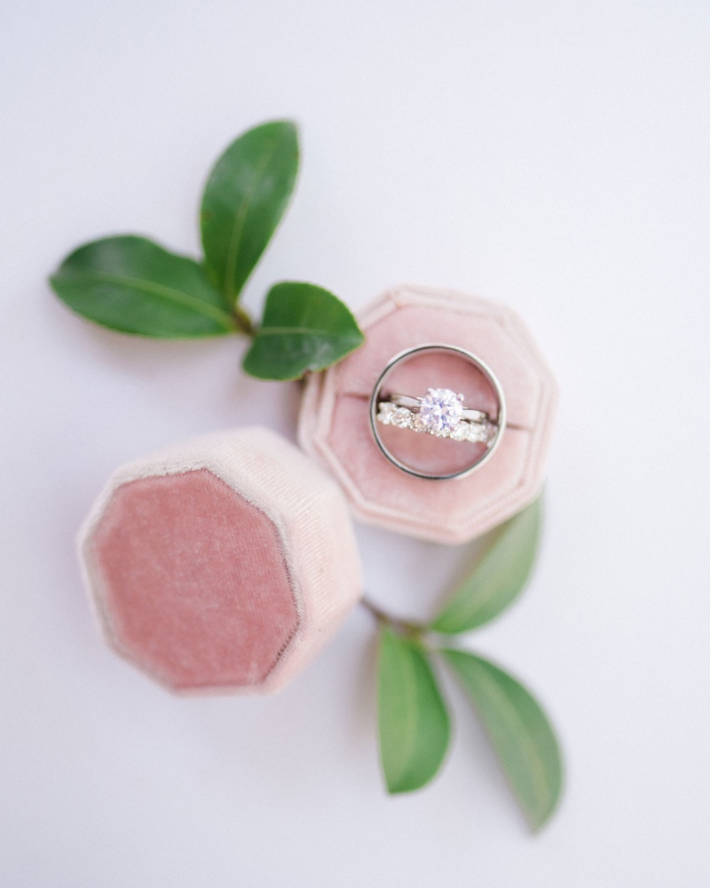 wedding rings eternity band and solitaire engagement ring pink velvet ring box greenery