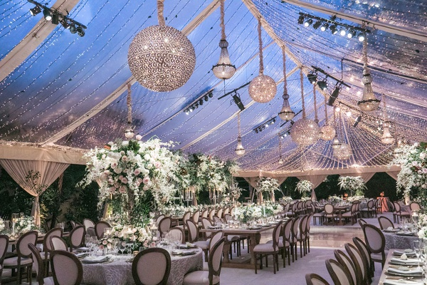 wedding reception tent clear top chandeliers string lights rustic elegant decor tent reception