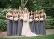 Bride with six bridesmaids in grey strapless floor length dresses