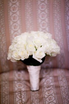 Still life image of ivory rose wedding bouquet