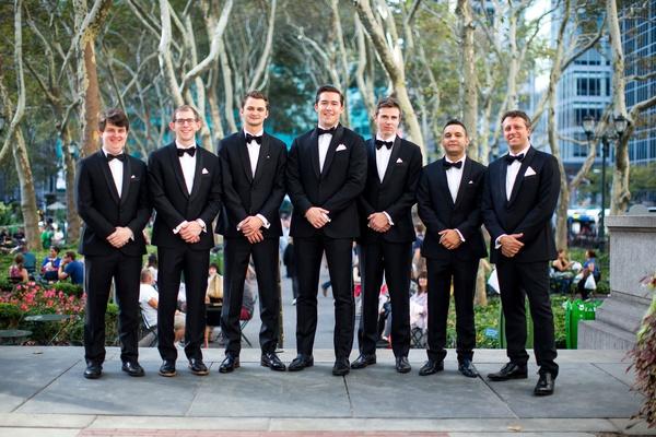 Groom in tuxedo bow tie black and white suit wedding day men's attire