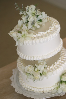Two layer cake with white flowers