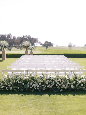 wedding ceremony at the lodge at torrey pines greenery white flowers white chairs outdoor wedding