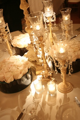 Wedding reception table with crystal candleholders and white roses