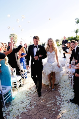 Celebrity Joanna Krupa wedding exit with flower petal tossing