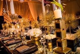 art deco inspired reception, unique black and gold decor,