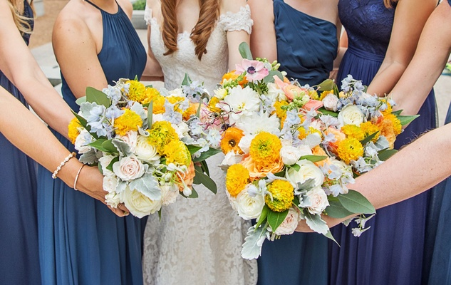 Bridesmaid and bridal bouquet marigold flowers greenery white roses wedding flowers