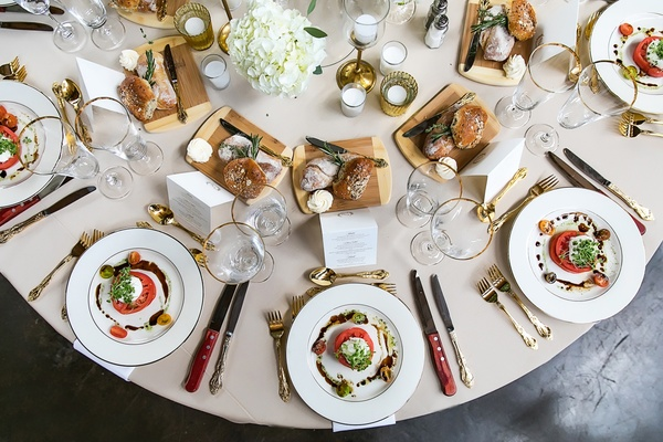 wedding reception, tomato and burrata salad, different breads and butter at table
