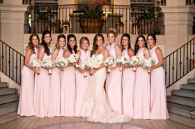 Bride in Ines Di Santo wedding dress with bridesmaids in pink bridesmaid dresses bouquets