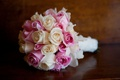 Ivory and blush roses and orchids wrapped in white