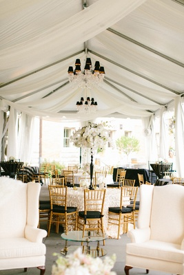 gold chiavari chairs with black bushions, crystal chandeliers with black lampshades