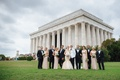 Wedding party for washington dc wedding in front of lincoln memorial columns grass courtyard