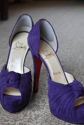 Deep purple peep toe heels by Christian Louboutin.