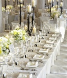 Tent wedding rectangular table with white flowers and candles