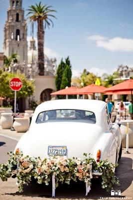 Vintage Rolls Royce draped in floral garland