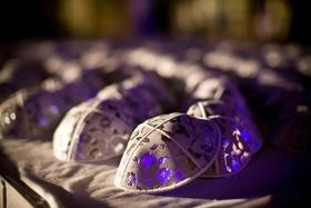 Grey yarmulke at Jewish wedding ceremony