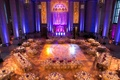 Andrew W. Mellon auditorium wedding with blue and purple uplighting