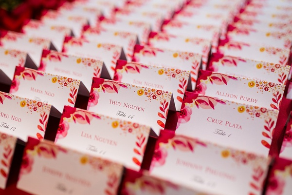 place cards with poppy and floral details