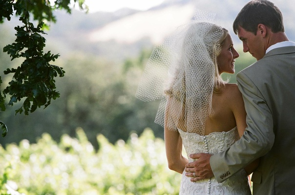 Bride in French net veil and lace wedding dress